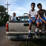 NEW ORLEANS, LA - AUGUST 20: Twin brothers and Hurricane Katrina survivors De'Shane and Dennis Sims, 14, pose before departing in a pickup truck after training at the Running Bear Boxing Club, run by their grandfather Harry Sims next to his home in the Lower Ninth Ward, on August 20, 2015 in New Orleans, Louisiana. The teens were four years old when they were rescued from the flooding in the neighborhood by their grandfather and taken to the Superdome. The gym was destroyed during Hurricane Katrina and it took about three years for Sims to be able to reuild the club. A number of youngsters train there on afternoons after school. The tenth anniversary of Hurricane Katrina, which killed at least 1836 and is considered the costliest natural disaster in U.S. history, is August 29. (Photo by Mario Tama/Getty Images)